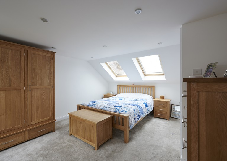 A luxury master bedroom with en-suite