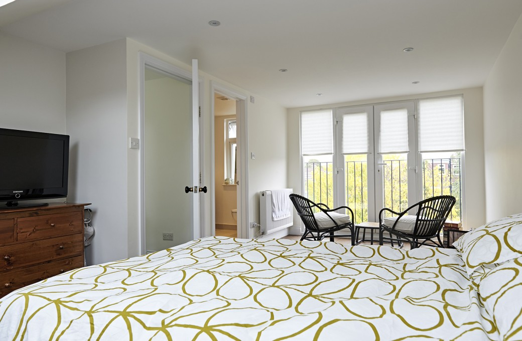 The bedroom in the new spacious loft conversion