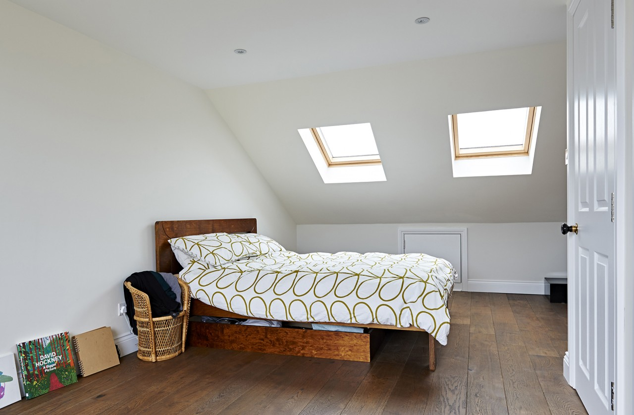 The new bedroom is well lit from the skylights