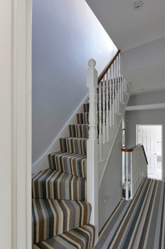 Stairs up to loft conversion with stripy carpet