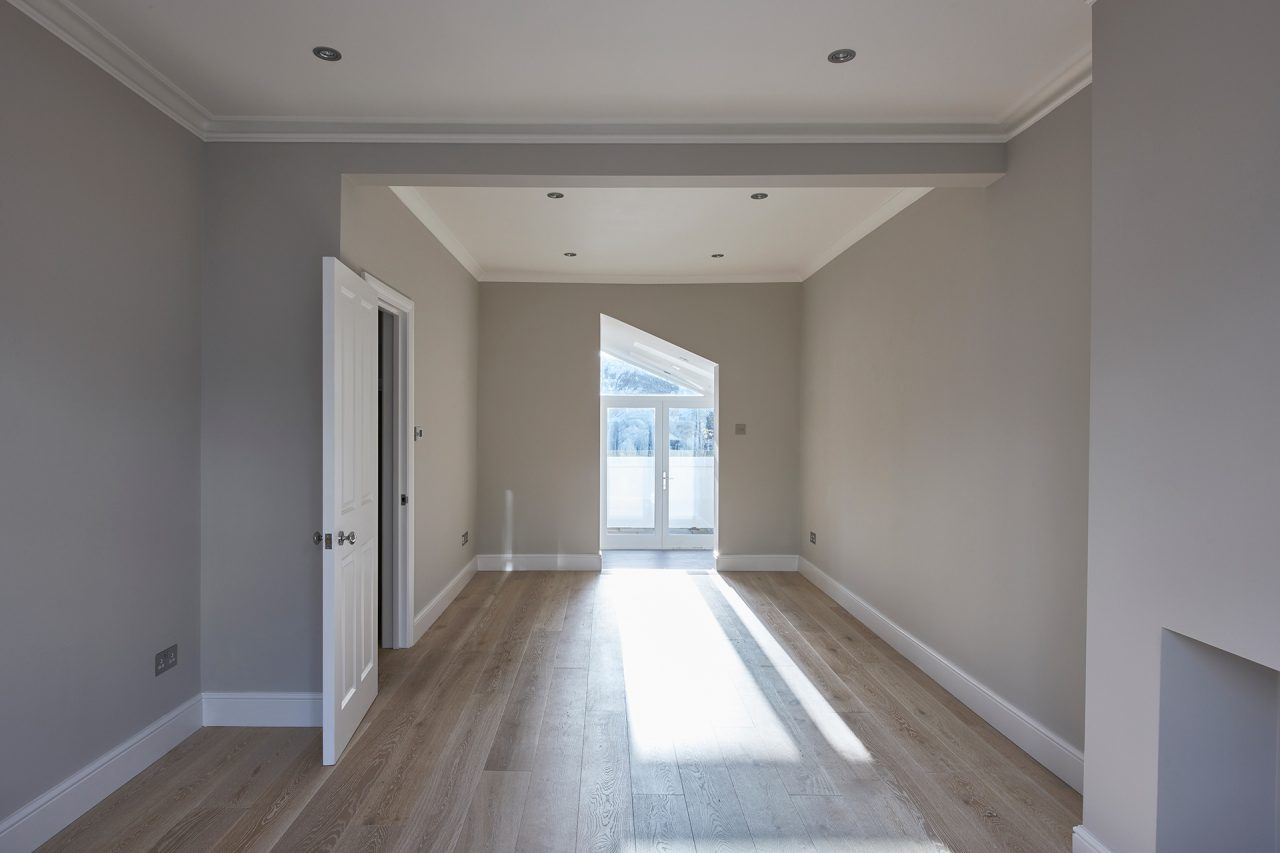 Empty extension with floorboards