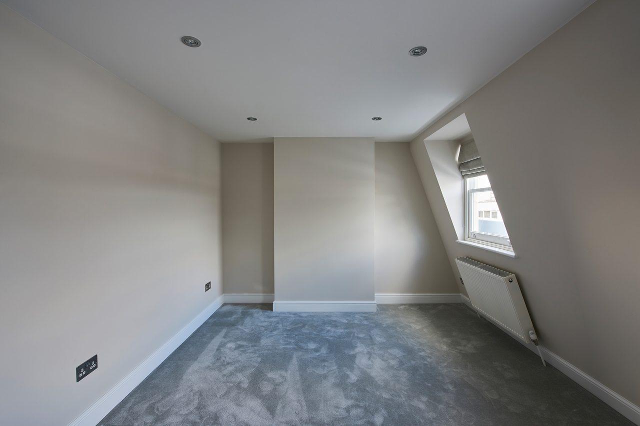 Loft conversion bedroom with carpet