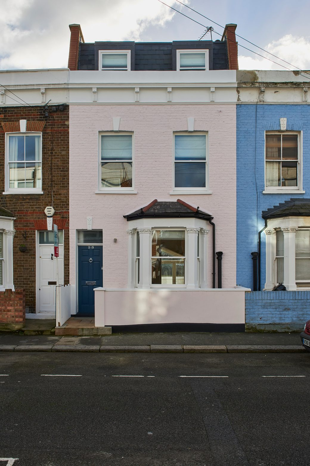 Light pink Victorian mid-terrace house