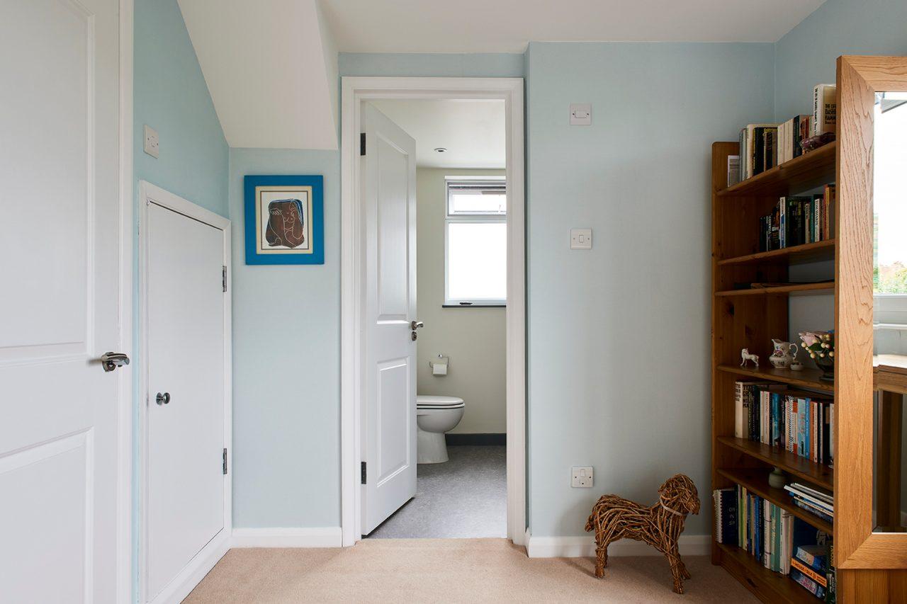 Corridor looking into bathroom