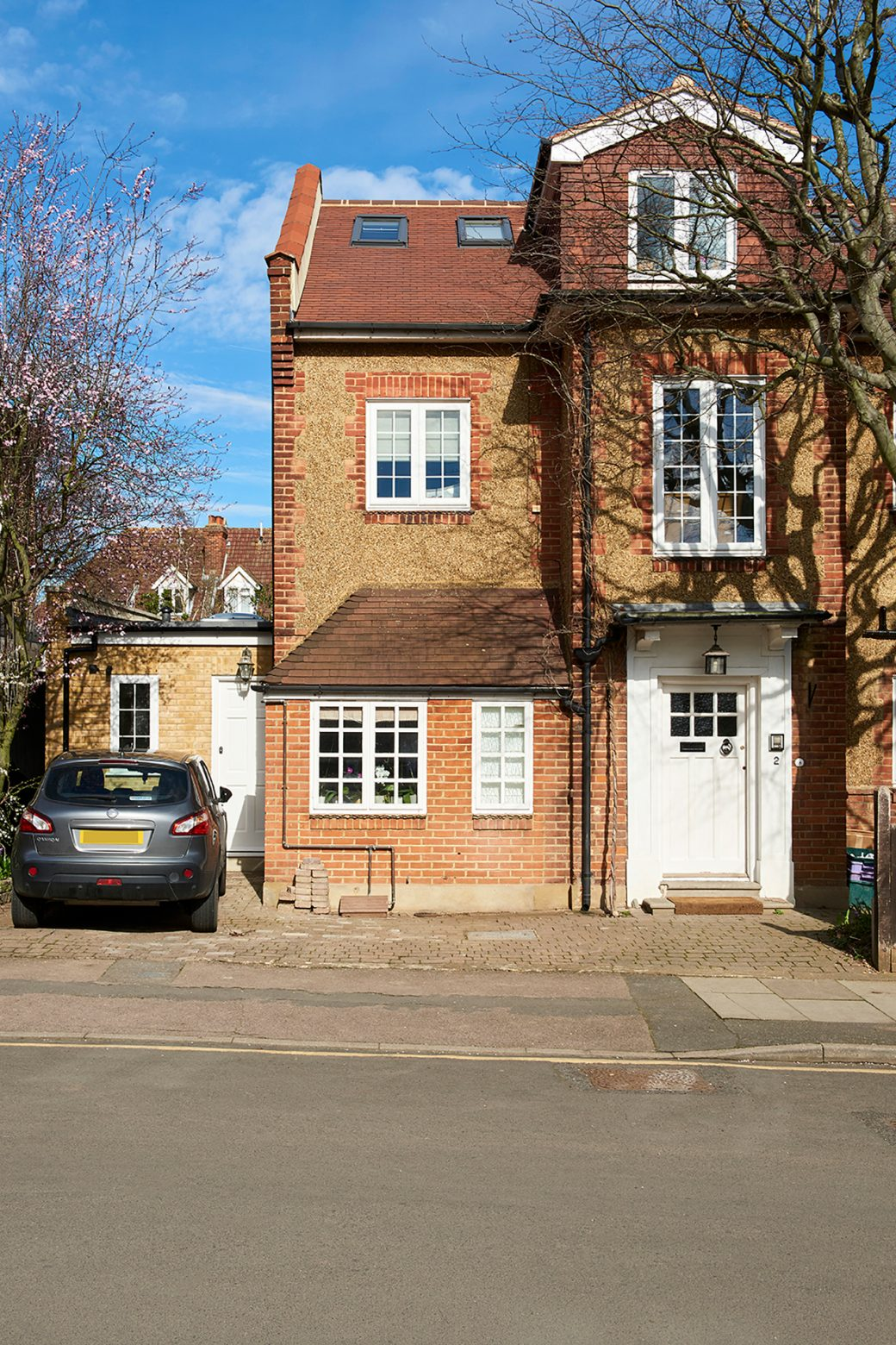 The front of the newly refurbished house with car parked outside