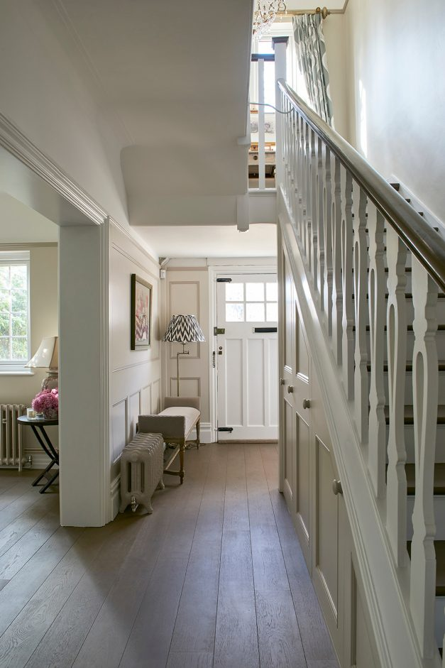 Stairs to the left with a view of the front door and open plan living