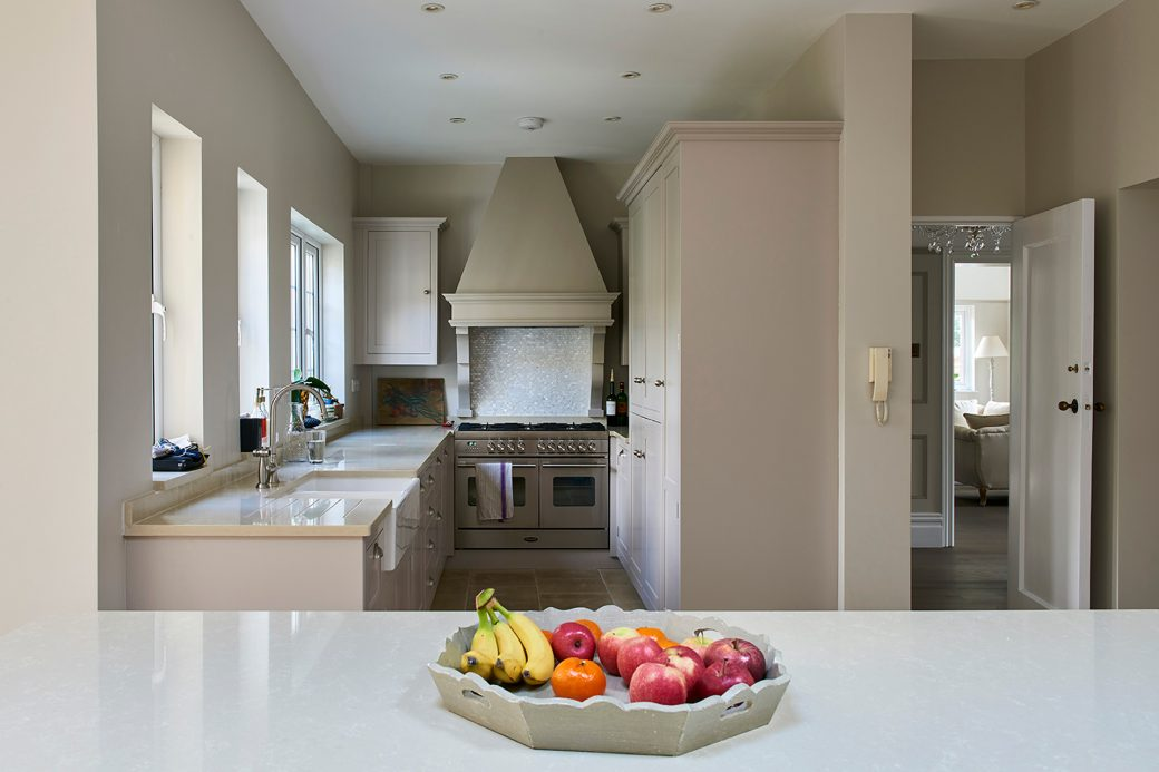 Kitchen with large double oven and tiled splashback