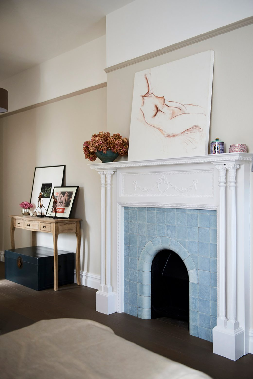 Fireplace in bedroom with blue tiles