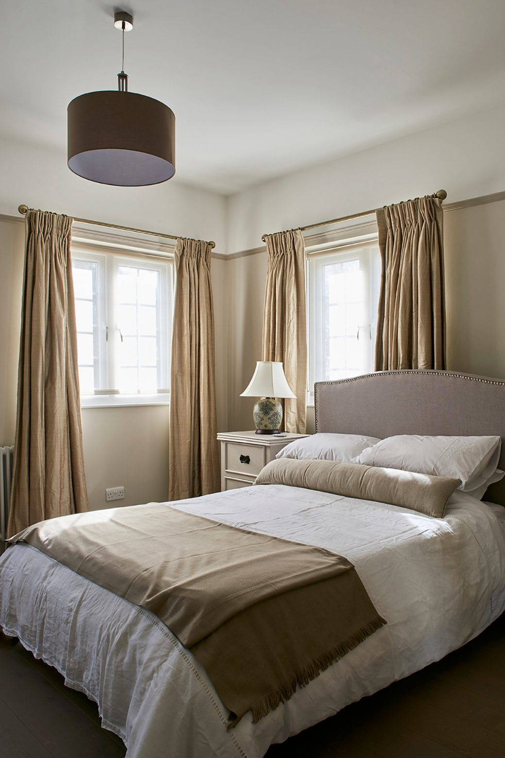 A brown and beige traditional bedroom