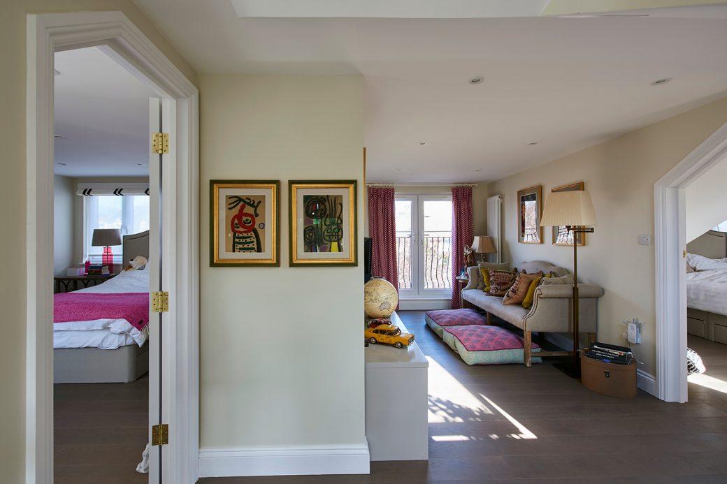 Relaxing area with open door to child's bedroom