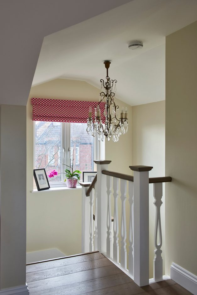 Top of stairs with chandelier