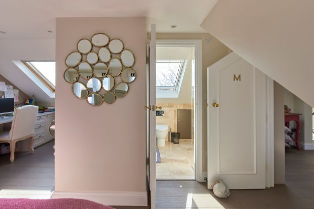 View of circle detail mirror, office area and en-suite