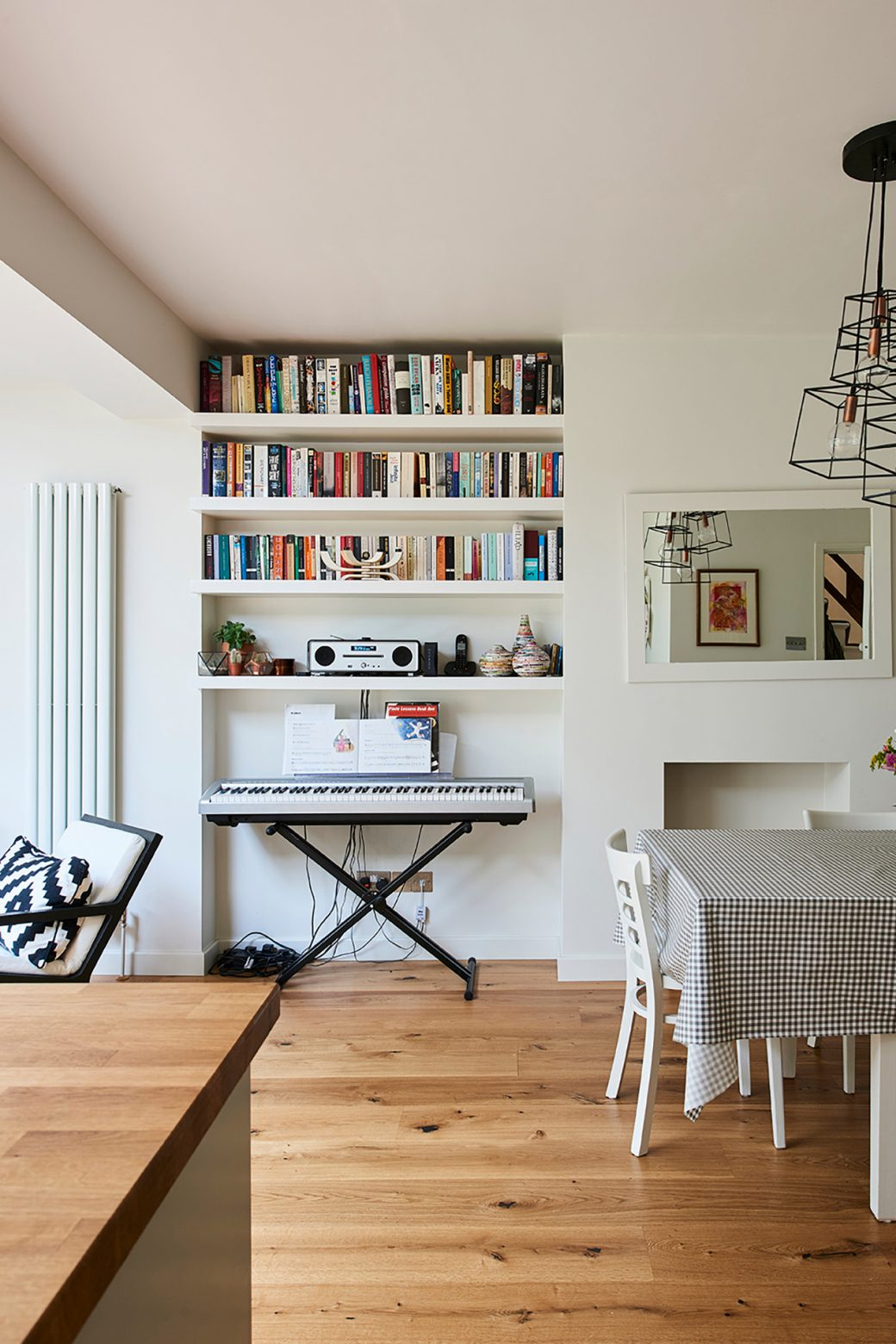 Dining area includes shelving for books