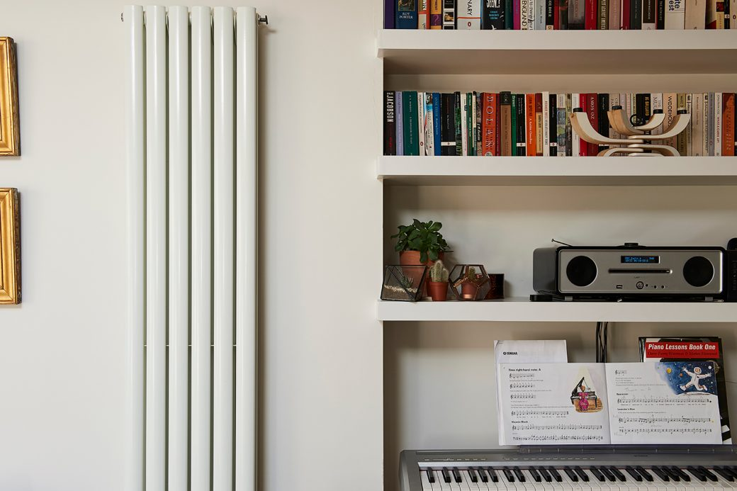 A vertical radiator fits into the space perfectly