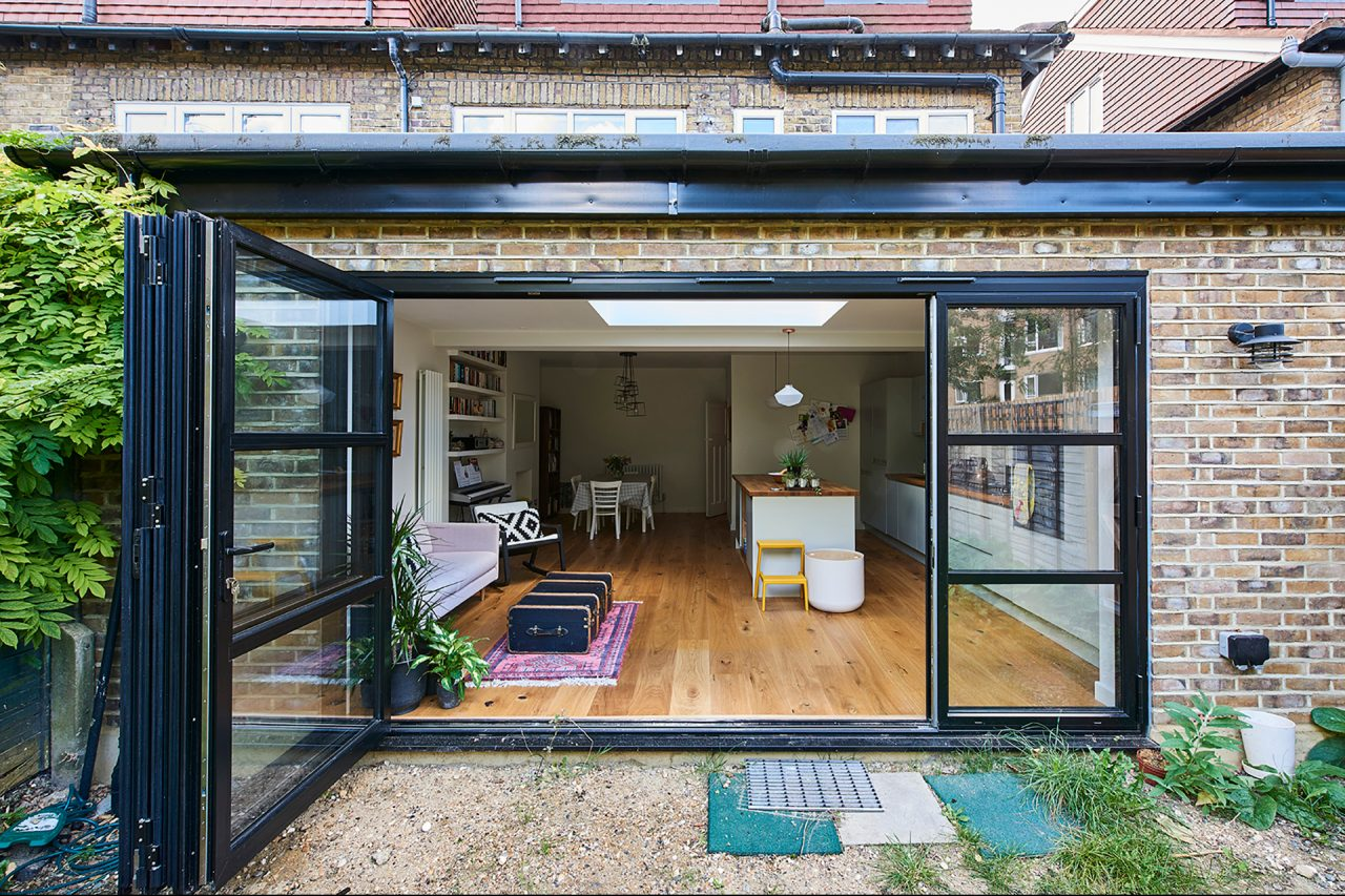 The view from the garden into the kitchen through open bifold doors