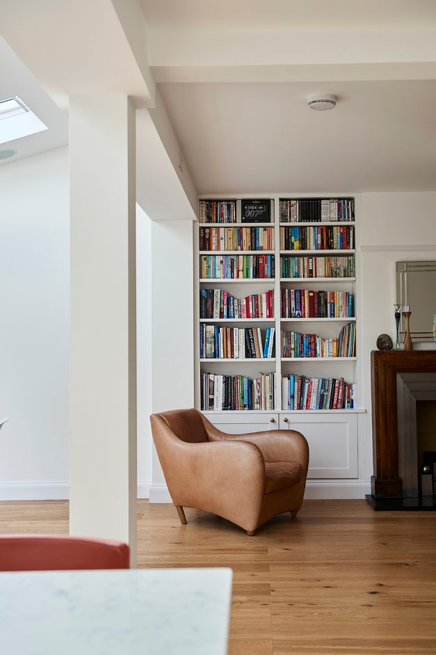 Book case and armchair in extension