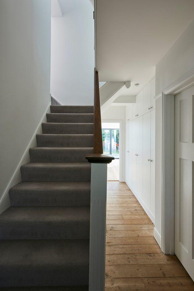 Carpet stairs with oak wood flooring hallway