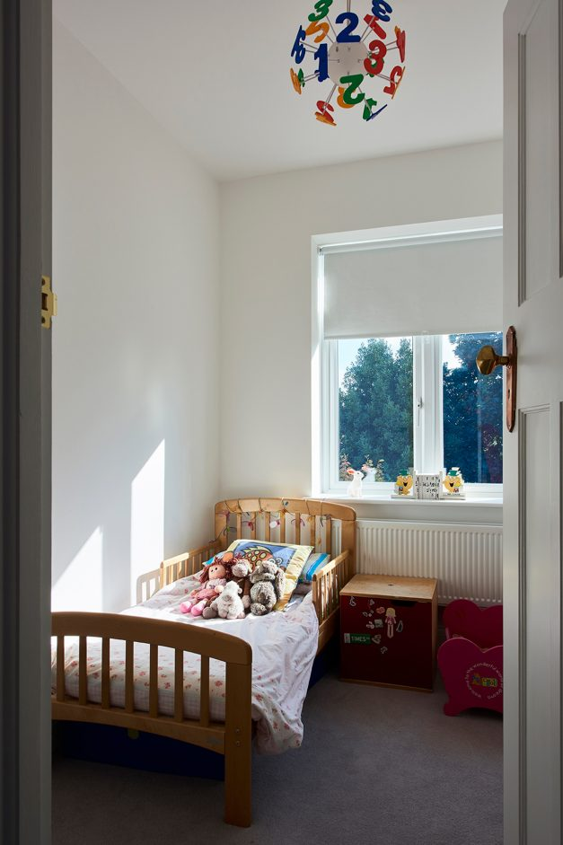 Kids single bedroom with oak furniture