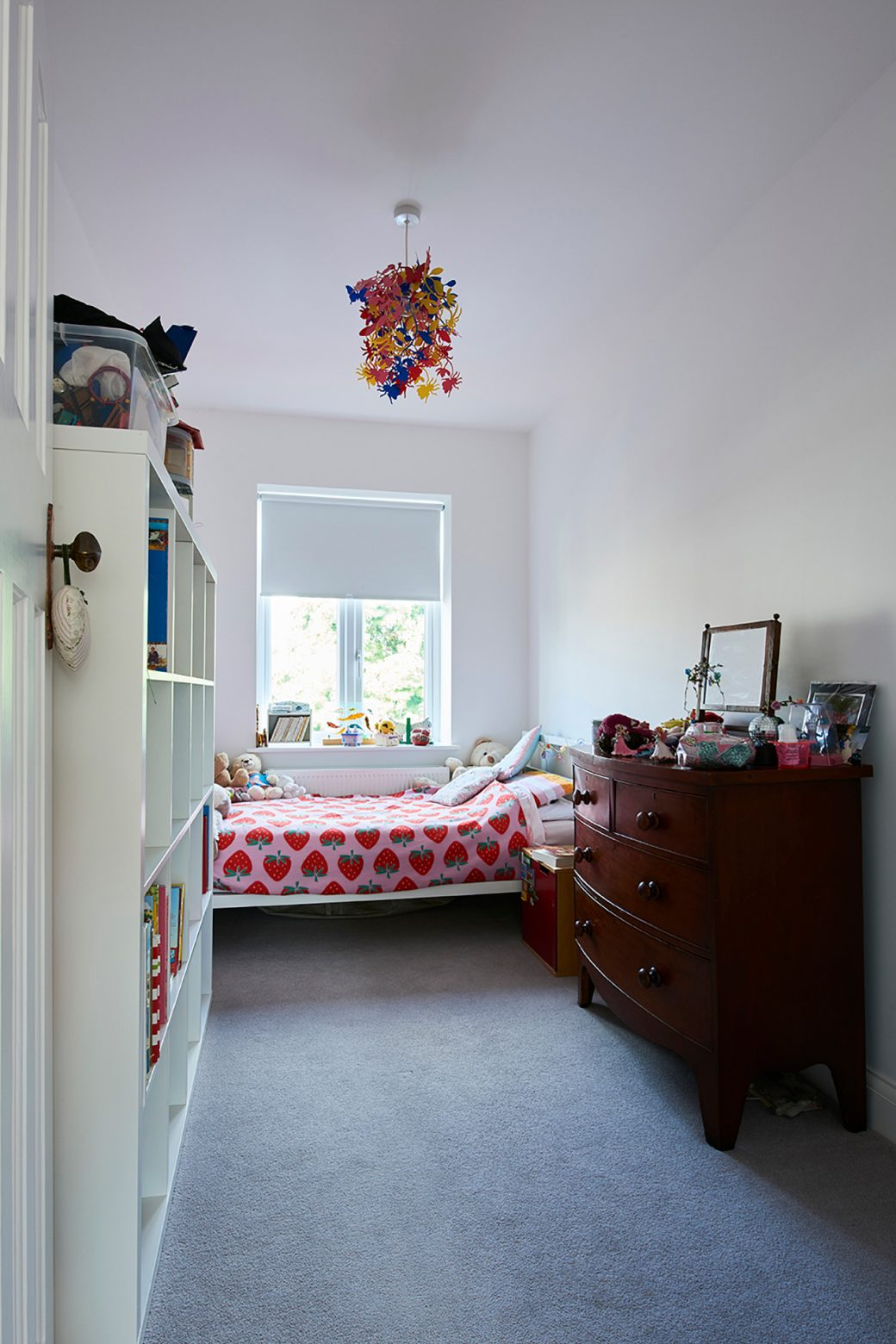 Kids bedroom with storage and fitted carpet