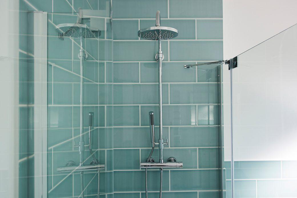 Detail of azure blue bathroom tiles
