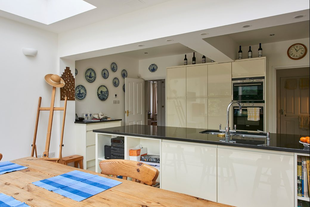 Newly installed kitchen with island overlooking dining area