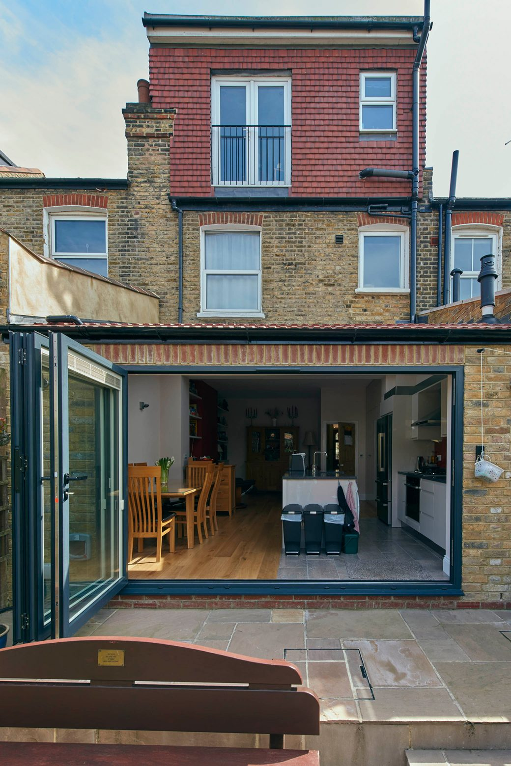 The exterior of the house with the bi-fold doors open