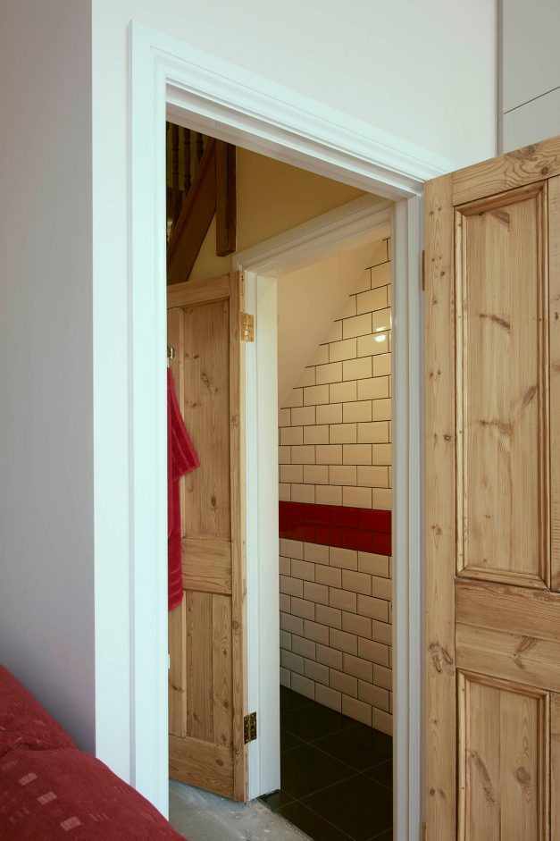 Doors leading to bathroom